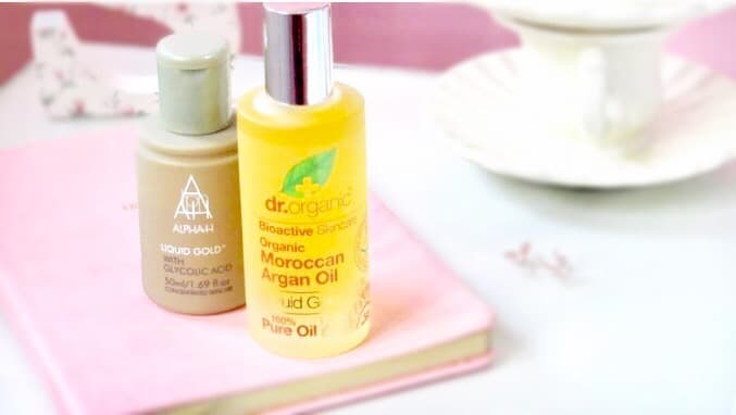 Image shows a bottle of Dr organic Argan oil plus a bottle of Alpha h liquid gold