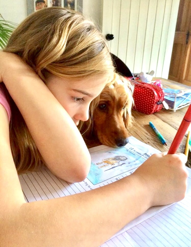 Lilymay with our dog doing some drawing