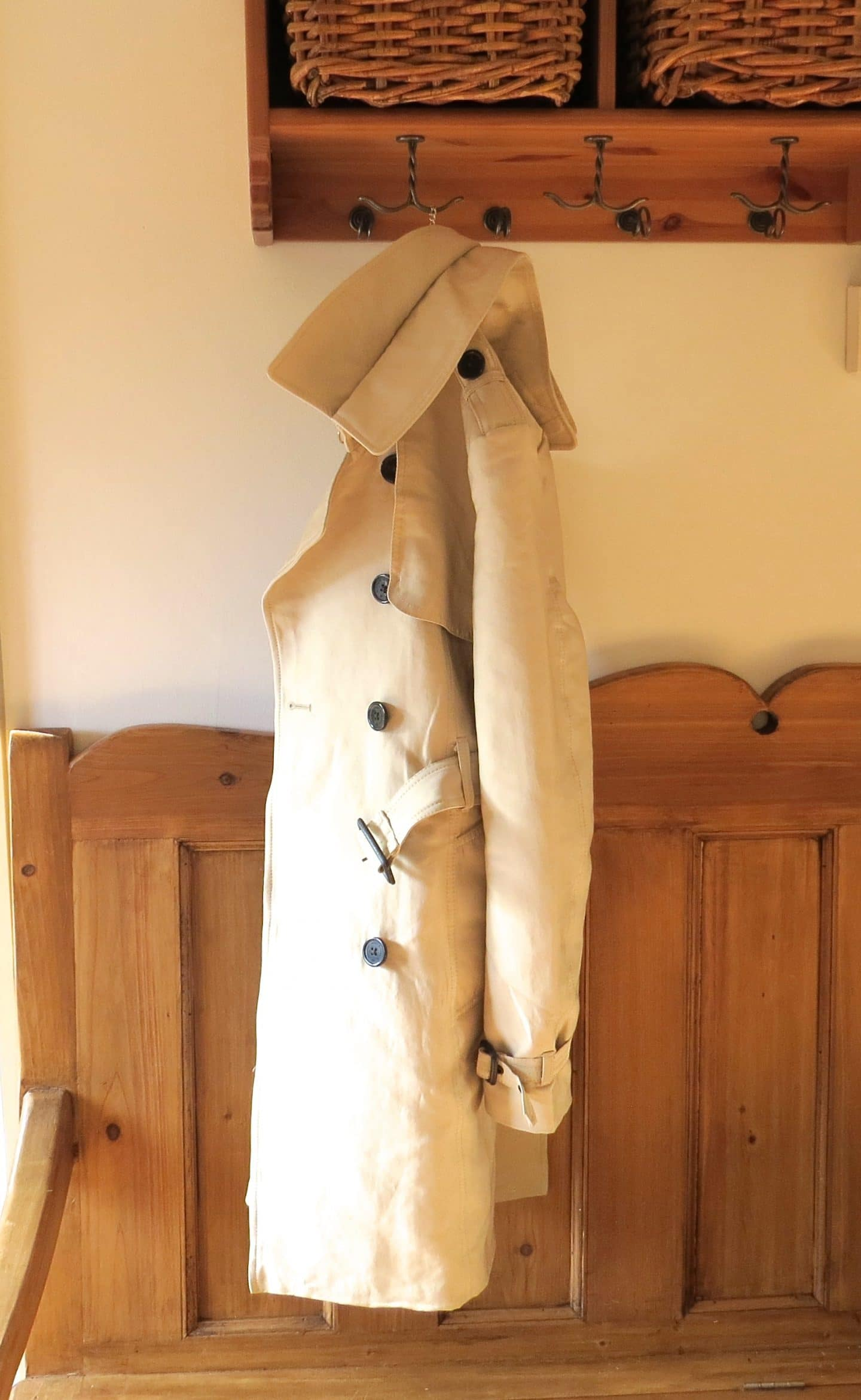 Super dry trench coat hanging up