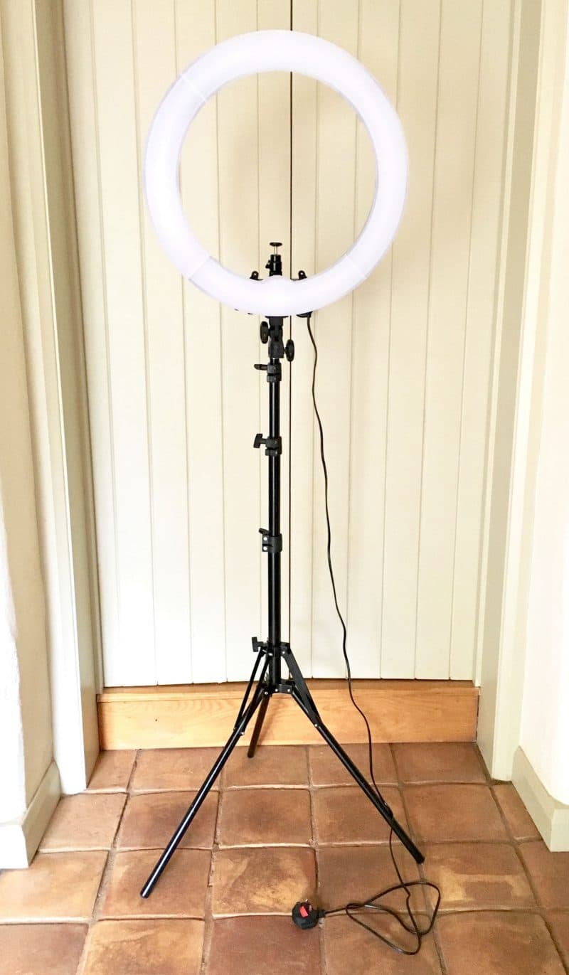 Neewer Ring Light with white diffuser and stand.