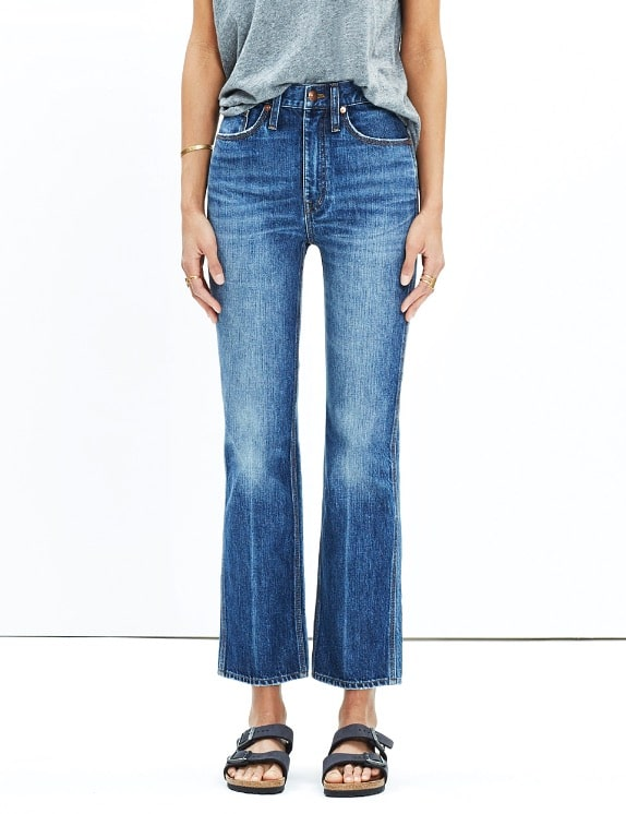 model wearing cropped flare jeans