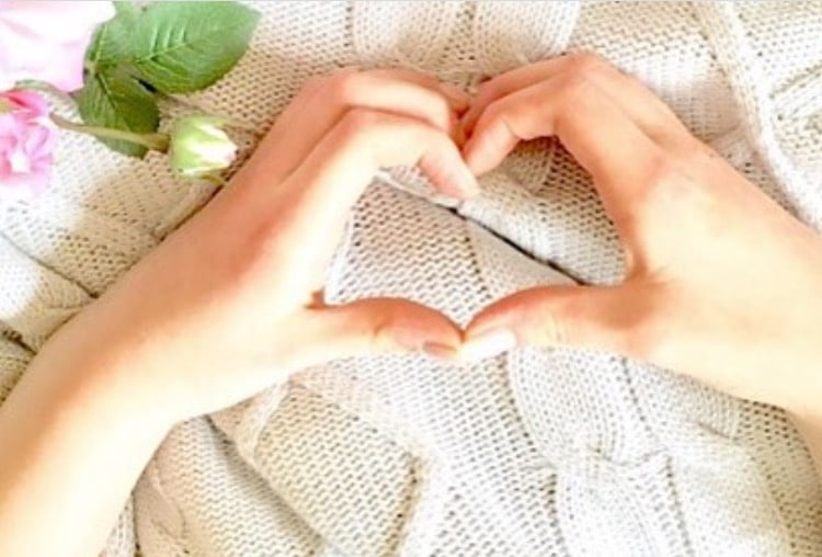 Samantha's hands forming a heart shape.