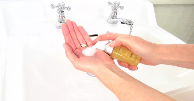 image shows me dispensing some of the Cleanse and Foam product onto my hand.