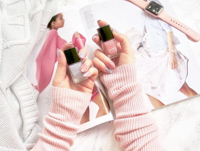 image shows my hands holding two Itsy polishes. City Girl Grey and Bohemian gypsy pink.
