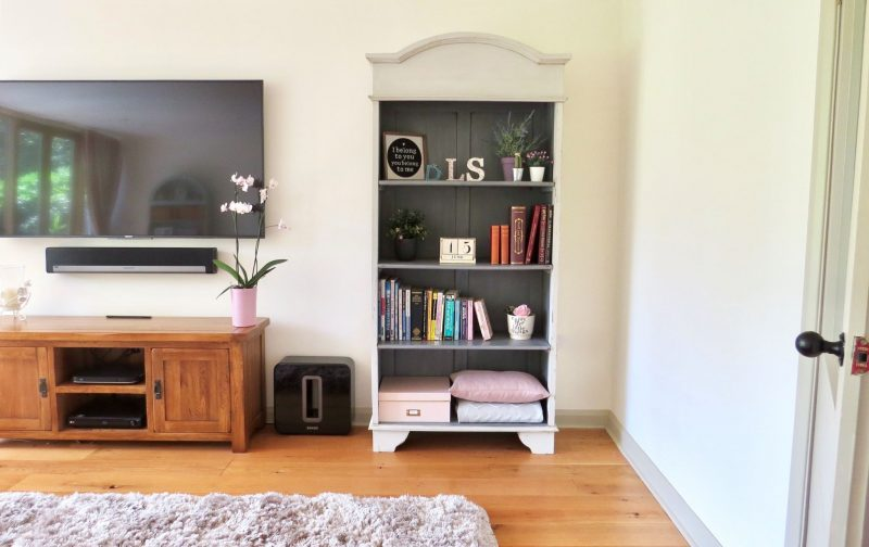 Image shows the finished bookcase dressed with books and ornaments etc.