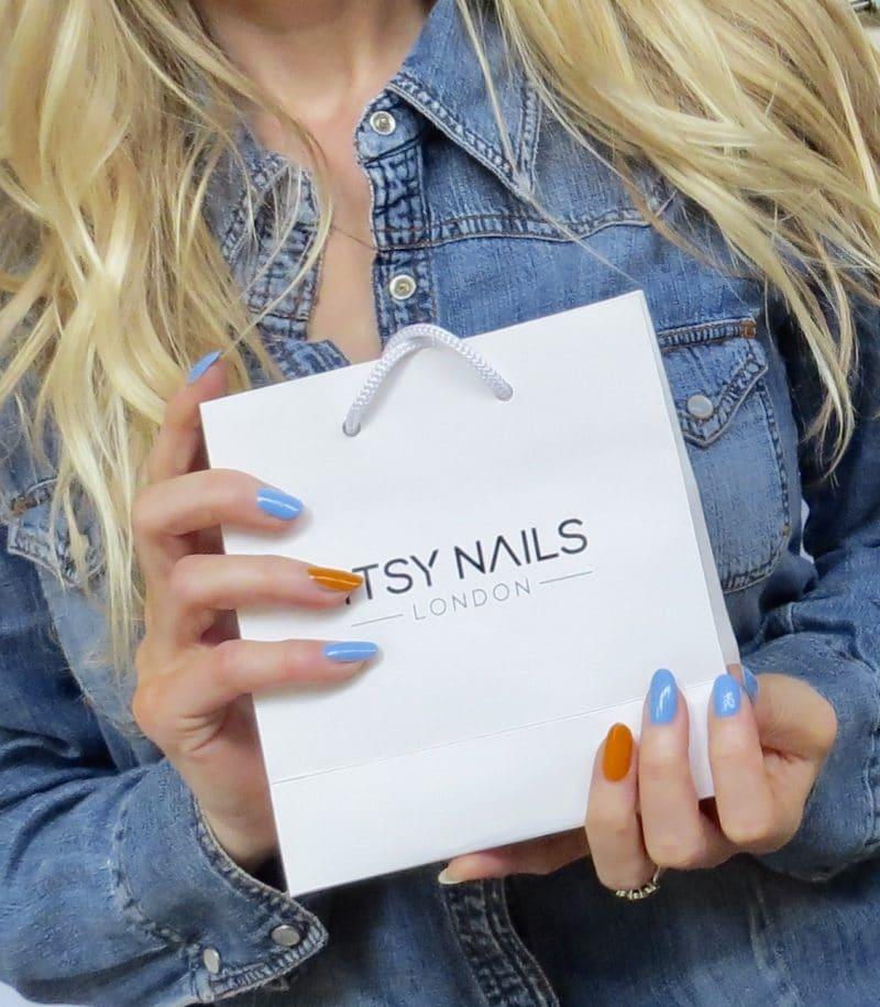 Samantha holding the Itsy nail polish gift bag