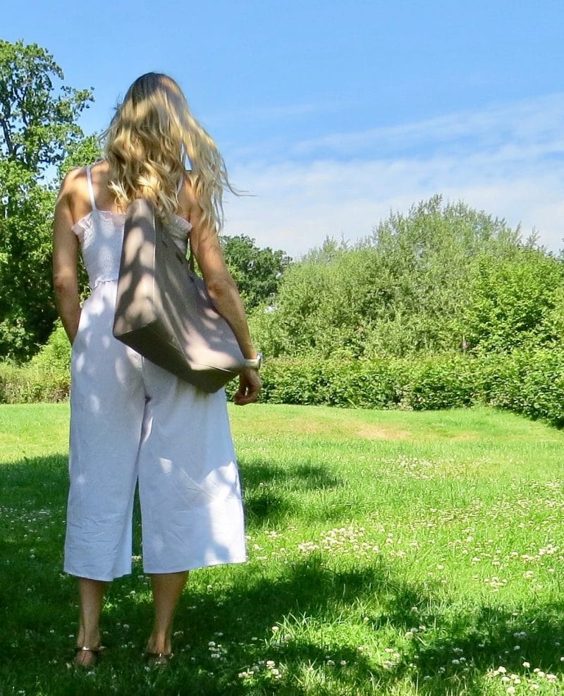 Image shows samantha from behind wearing Asos white jumpsuit.